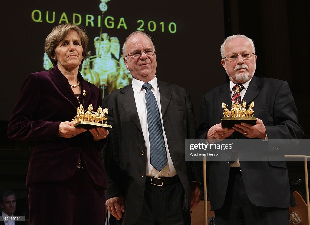 German philosopher and theologian Richard Schroeder (C) presents Quadriga awards to Ingeborg Schaeuble (L), standing in for her husband German Finance Minister Wolfgang Schaeuble who is currently in hospital and Lothar de Maiziere (R), German Christian Democrat (CDU) and last prime minister of the former East Germany (DDR) during the Quadriga awards ceremony at the Konzerthaus on Gendarmenmarkt on October 3, 2010 in Berlin, Germany.