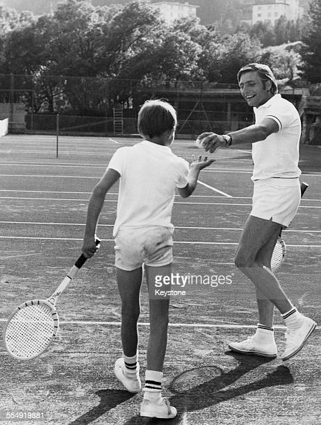 German photographer and industrialist Gunter Sachs playing tennis with his son Rolf duriing a holiday in St Moritz Switzerland August 1968