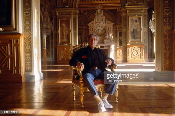 German photographer Helmut Newton poses in the great hall of the Paris City Hall after being presented with the Grand Prix de la Photographie by...