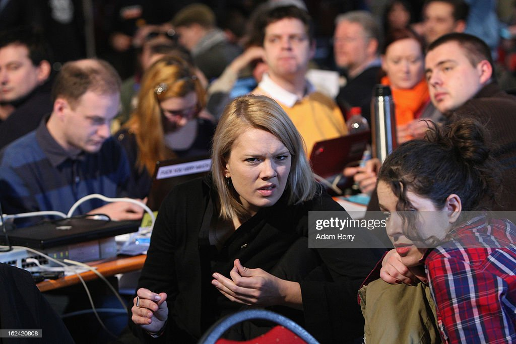 German Pirate Party member Laura Dornheim (C) attends a meeting of the Berlin chapter of the party on February 23, 2013 in Berlin, Germany. After successes in 2011 in regional elections in the German capital and in the following year in the states of Schleswig-Holstein and North Rhine-Westphalia, the German Pirate Party (Piratenpartei), which initially focused on filesharing, censorship and data protection, has seen two of its state-level leaders in the states of Brandenburg and Baden-Wuerttemburg step down in the past few days alone. The party's Berlin representation is meeting over the weekend to choose its candidates for the country's federal elections, to be held on September 22, 2013, which will determine the 598 or more members of the 18th Bundestag, Germany's federal parliament. After well-publicized infighting in the party, many observers are skeptical that the party can reach the 5 percent vote required to join the country's politics on that level.