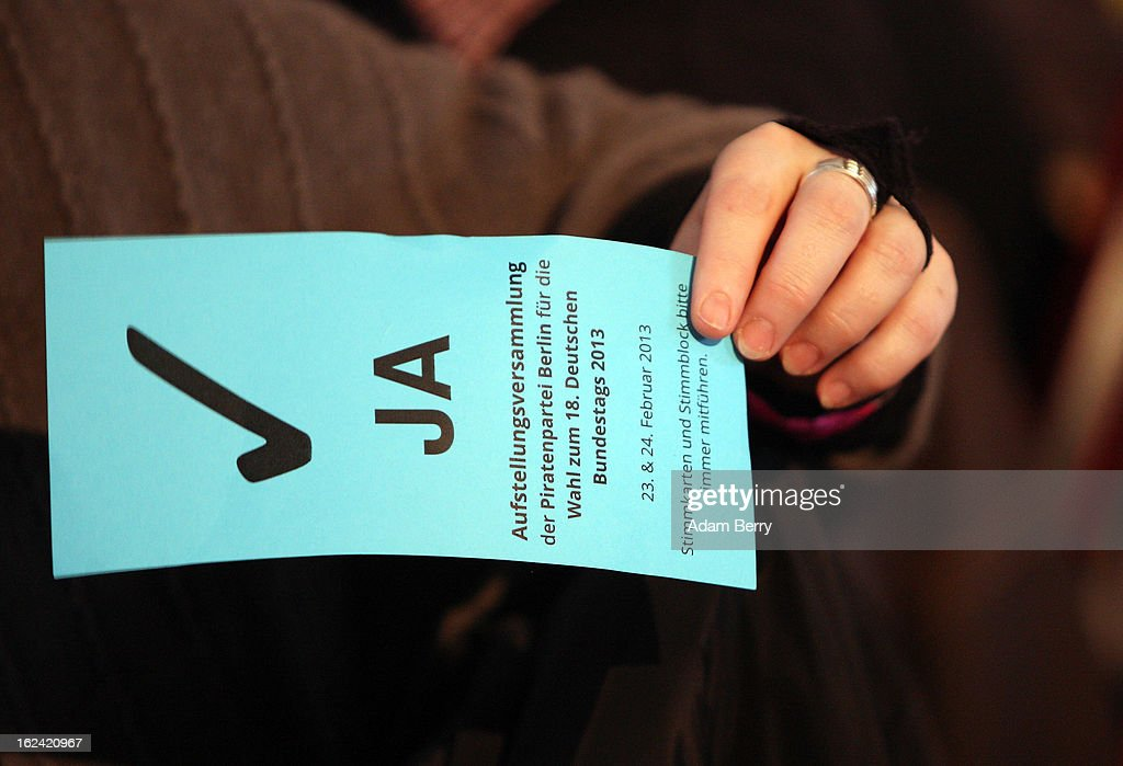 A German Pirate Party supporter holds a card signifying a 'yes' vote during a meeting of the Berlin chapter of the party on February 23, 2013 in Berlin, Germany. After successes in 2011 in regional elections in the German capital and in the following year in the states of Schleswig-Holstein and North Rhine-Westphalia, the German Pirate Party (Piratenpartei), which initially focused on filesharing, censorship and data protection, has seen two of its state-level leaders in the states of Brandenburg and Baden-Wuerttemburg step down in the past few days alone. The party's Berlin representation is meeting over the weekend to choose its candidates for the country's federal elections, to be held on September 22, 2013, which will determine the 598 or more members of the 18th Bundestag, Germany's federal parliament. After well-publicized infighting in the party, many observers are skeptical that the party can reach the 5 percent vote required to join the country's politics on that level.
