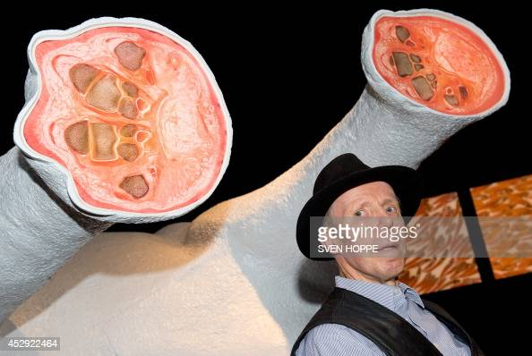German 'plastinator' Gunther von Hagen poses for photographers during the opening of his special exhibition 'Cuts Forays in Anatomical Art' as part...
