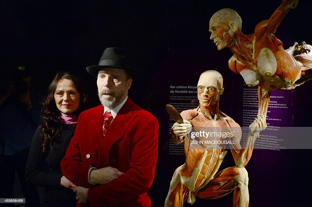 German plastinator <a gi-track='captionPersonalityLinkClicked' href=/galleries/search?phrase=Gunther+von+Hagens&family=editorial&specificpeople=226597 ng-click='$event.stopPropagation()'>Gunther von Hagens</a> (R) and his wife and curator Angelina Whally pose in front of plastinated bodies at the 'Menschen Museum' (Human Being Museum) on the eve of its opening in Berlin, on February 17, 2015. German anatomist <a gi-track='captionPersonalityLinkClicked' href=/galleries/search?phrase=Gunther+von+Hagens&family=editorial&specificpeople=226597 ng-click='$event.stopPropagation()'>Gunther von Hagens</a>, dubbed 'Doctor Death' for preserving and displaying dead bodies as artworks, opens a museum dedicated to the technique called plastination, after 20 years of touring the world with this controversial exhibition of human complete corpses and organs.