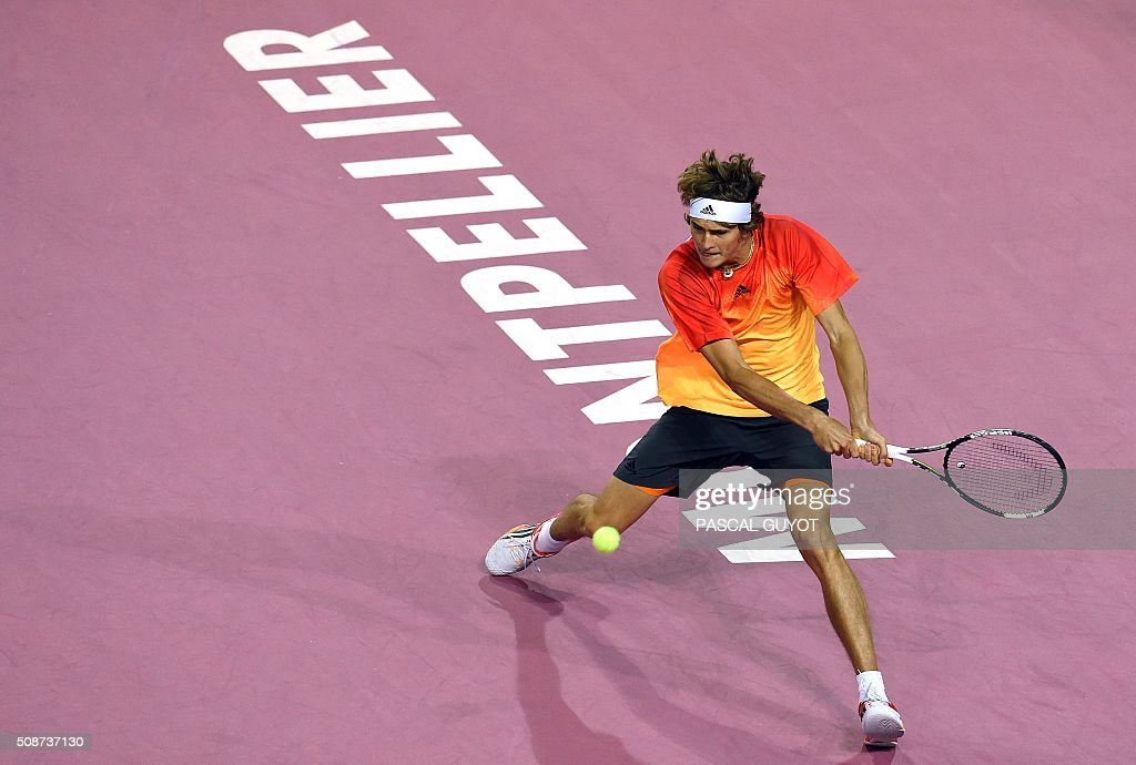 German player Alexander Zverev returns the ball to the French player Paul-Henri Mathieu during their semifinal tennis match at the Open Sud de France ATP World Tour in Montpellier, southern France, on February 6, 2016. / AFP / PASCAL GUYOT