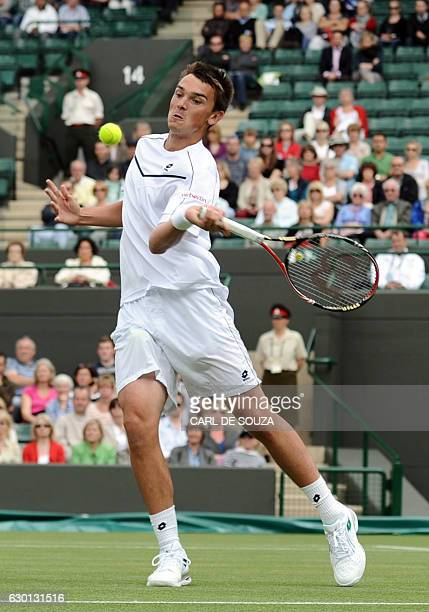 German player Andreas Beck returns the ball to US player Andy Roddick during the men's single at the Wimbledon Tennis Championships at the All...