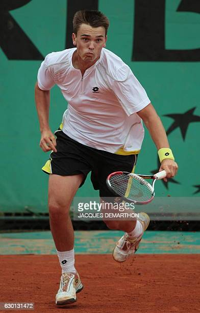 German player Andreas Beck runs for a return to French player Marc Gicquel during their French Open tennis second round match on May 28 2009 at...