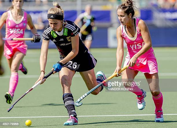 German player Hannah Gablac vies for the ball with Argentine player Rocio Sanchez during the Field Hockey World Cup Women's tournament match Germany...