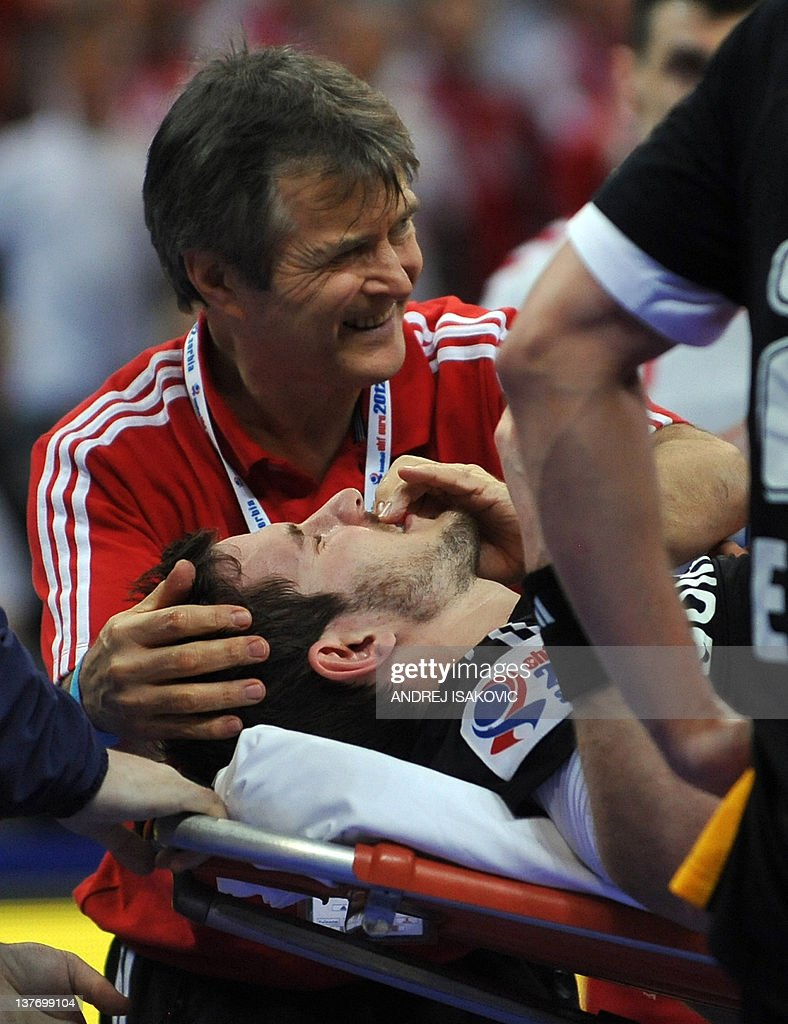 German player Michael Haas is been treated for a foot injury after a scuffle with Polish Krzysztof Lijewski during their Men's EHF Euro 2012 Handball Championship match Poland vs Germany on January 25, 2012, at the Belgrade Arena. During this incident German Michael Haas was escorted of the court with a broken foot.