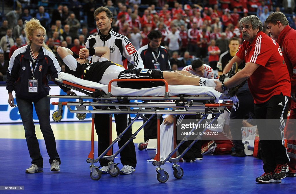 German player Michael Haas is stretchered after a foot injury after a scuffle with Polish Krzysztof Lijewski during their Men's EHF Euro 2012 Handball Championship match Poland vs Germany on January 25, 2012, at the Belgrade Arena. During this incident German Michael Haas was escorted of the court with a broken foot.
