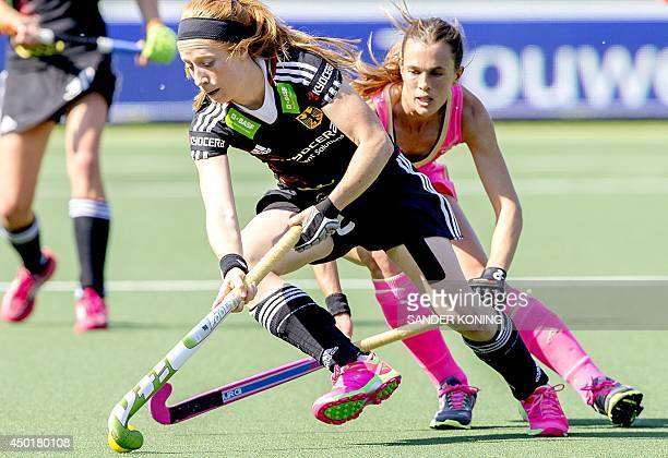 German player Nina Hasselmann vies with Argentine player Rocio Sanchez during the Field Hockey World Cup Women's tournament match Germany vs...
