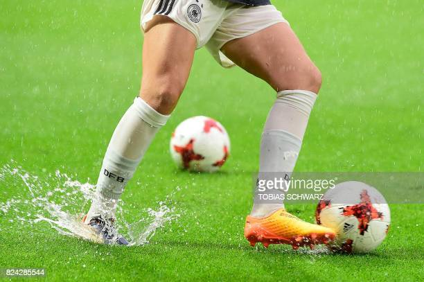 A German player warms up under the rain prior to the start of the UEFA Womens Euro 2017 football quarterfinals match between Germany and Denmark at...