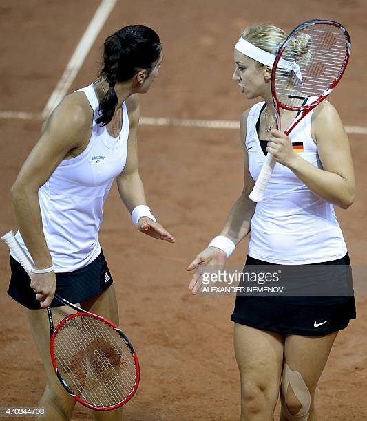 German players Andrea Petkovic and Sabine Lisicki react as they play against Russia's Anastasia Pavlyuchenkova and Elena Vesnina during their...