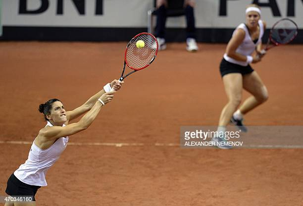 German players Andrea Petkovic and Sabine Lisicki return a service to Russia's Anastasia Pavlyuchenkova and Elena Vesnina during their Federation Cup...