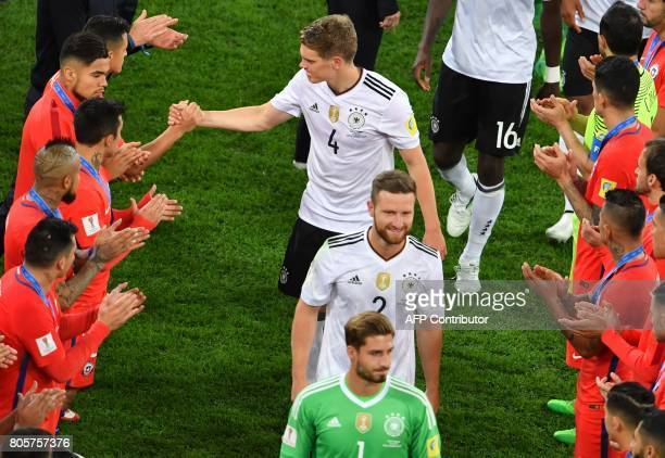 German players are applauded as they walk to the podium to receive their medals after winning the 2017 Confederations Cup final football match...