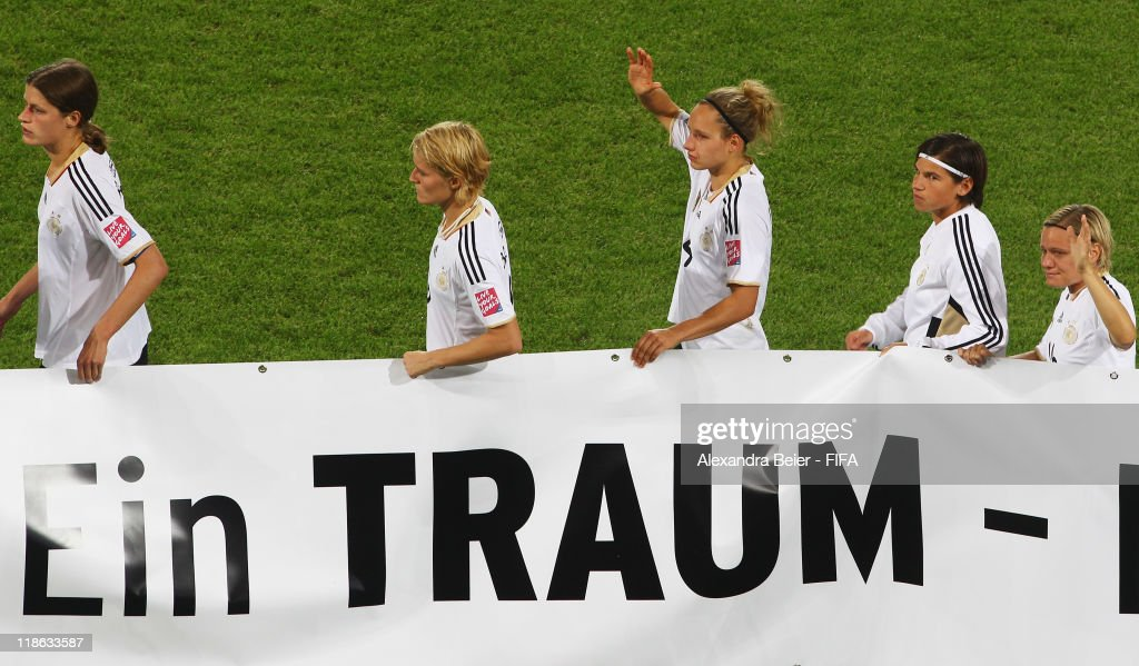 German players carry a banner reading 'A dream' after their team's loss in the FIFA Women's World Cup quarter finals match between Germany and Japan on July 9, 2011 in Wolfsburg, Germany.