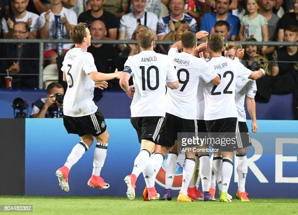 German players celebarte after the opening goal by Germany's midfielder Mitchell Weiser during the UEFA U21 European Championship football final...