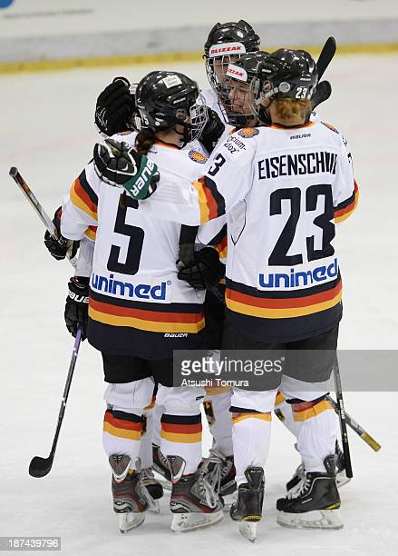 German players celebrate a goal in the match between Slovakia and Germany during day three of the Ice Hockey Women's 5 Nations Tournament at the Shin...