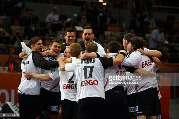 German players celebrate after defeating Russia during the 24th Men's Handball World Championships preliminary round Group D match at the Lusail...