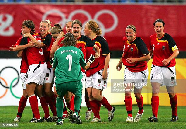 German players celebrate after Kerstin Garefrekes scored the first goal during the Women's Quarter Final match between Sweden and Germany at Shenyang...
