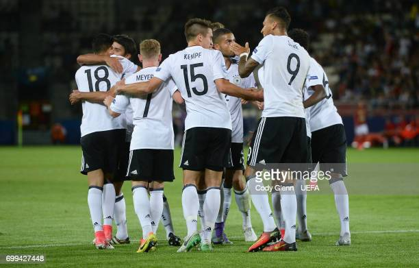 German players celebrate after Marc Oliver Kempf scored his side's second goal during their UEFA Under21 Championship Group C match between Germany...