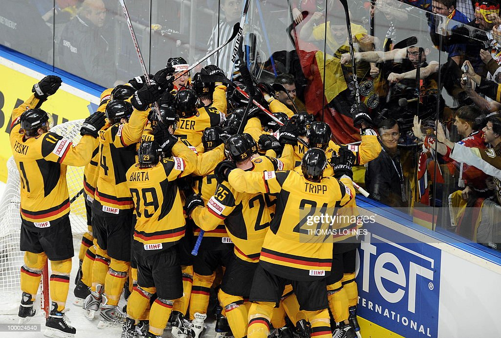 German players celebrate after the IIHF Ice Hockey World Championship quarter-final match Switzerland vs Germany in the southern German city of Mannheim on May 20, 2010. The 2010 IIHF Ice Hockey World Championships are taking place in Germany from May 7 to 23, 2010. Germany won the match 0-1.