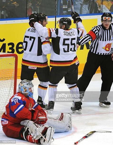 German players celebrate scoring past Russian goalkeeper Vasili Koshechkin during the IIHF Ice Hockey World Championship semifinal match Russia vs...