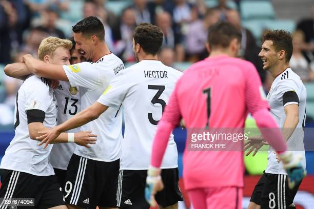 TOPSHOT German players celebrate the match's first goal by Germany's midfielder Lars Stindl during the 2017 Confederations Cup group B football match...