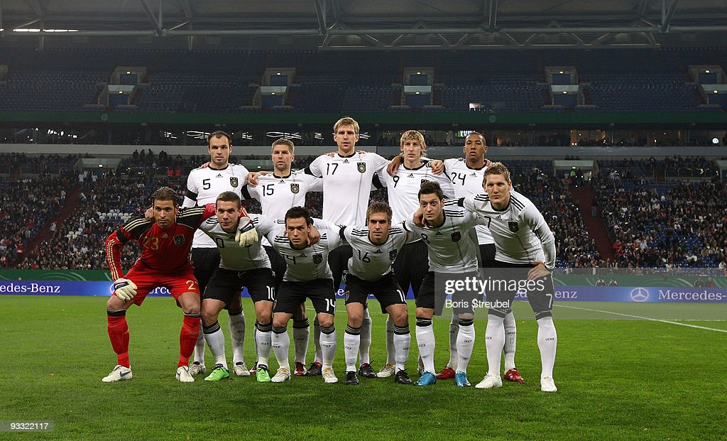 German players (back row - L-R) <a gi-track='captionPersonalityLinkClicked' href=/galleries/search?phrase=Heiko+Westermann&family=editorial&specificpeople=623650 ng-click='$event.stopPropagation()'>Heiko Westermann</a>, <a gi-track='captionPersonalityLinkClicked' href=/galleries/search?phrase=Thomas+Hitzlsperger&family=editorial&specificpeople=486612 ng-click='$event.stopPropagation()'>Thomas Hitzlsperger</a>, <a gi-track='captionPersonalityLinkClicked' href=/galleries/search?phrase=Per+Mertesacker&family=editorial&specificpeople=207135 ng-click='$event.stopPropagation()'>Per Mertesacker</a>, <a gi-track='captionPersonalityLinkClicked' href=/galleries/search?phrase=Stefan+Kiessling&family=editorial&specificpeople=605405 ng-click='$event.stopPropagation()'>Stefan Kiessling</a>, <a gi-track='captionPersonalityLinkClicked' href=/galleries/search?phrase=Jerome+Boateng&family=editorial&specificpeople=2192287 ng-click='$event.stopPropagation()'>Jerome Boateng</a>, (front row L-R) <a gi-track='captionPersonalityLinkClicked' href=/galleries/search?phrase=Tim+Wiese&family=editorial&specificpeople=635015 ng-click='$event.stopPropagation()'>Tim Wiese</a> , <a gi-track='captionPersonalityLinkClicked' href=/galleries/search?phrase=Lukas+Podolski&family=editorial&specificpeople=204460 ng-click='$event.stopPropagation()'>Lukas Podolski</a>, <a gi-track='captionPersonalityLinkClicked' href=/galleries/search?phrase=Piotr+Trochowski&family=editorial&specificpeople=635014 ng-click='$event.stopPropagation()'>Piotr Trochowski</a>, <a gi-track='captionPersonalityLinkClicked' href=/galleries/search?phrase=Philipp+Lahm&family=editorial&specificpeople=483746 ng-click='$event.stopPropagation()'>Philipp Lahm</a>, <a gi-track='captionPersonalityLinkClicked' href=/galleries/search?phrase=Mesut+Oezil&family=editorial&specificpeople=764075 ng-click='$event.stopPropagation()'>Mesut Oezil</a> and <a gi-track='captionPersonalityLinkClicked' href=/galleries/search?phrase=Bastian+Schweinsteiger&family=editorial&specificpeople=203122 ng-click='$event.stopPropagation()'>Bastian Schweinsteiger</a> line up for a team photo prior to the international friendly match between Germany and Ivory Coast at the Schalke Arena on November 18, 2009 in Gelsenkirchen, Germany.