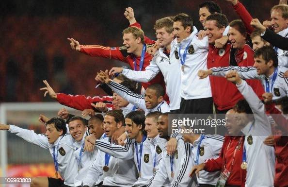 German players pose during a medal ceremony after the 2010 World Cup third place match Uruguay vs Germany on July 10 2010 at the Nelson Mandela Bay...