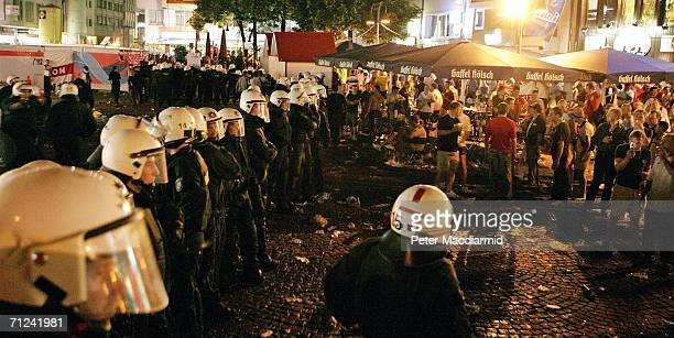 German police blockade a square in central Cologne after a brief scuffle with English supporters on June 19 2006 in Cologne Germany England will face...
