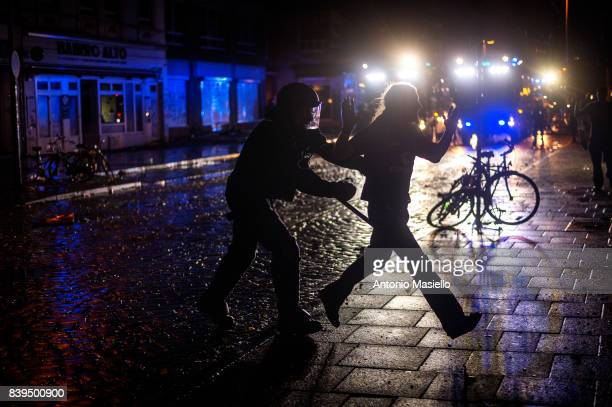 German police clashes against anticapitalist demonstrator during night of riots on July 8 2017 in Hamburg northern Germany German police and...