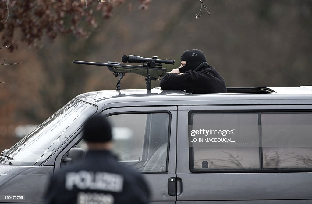 A German police commando secures the area in front of the Chancellery during US vice-President Joe Biden's meeting with German Chancellor Angela Merkel in Berlin February 1, 2013. World leaders, ministers and top military brass attend three days of talks at the Munich Security Conference amid a US warning to Iran over stalled nuclear talks.