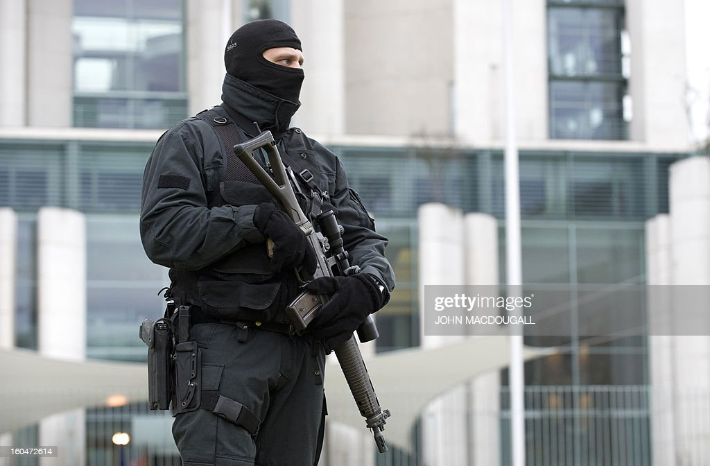 A German police commando stands guard in front of the Chancellery during US vice-President Joe Biden's meeting with German Chancellor Angela Merkel in Berlin February 1, 2013. World leaders, ministers and top military brass attend three days of talks at the Munich Security Conference amid a US warning to Iran over stalled nuclear talks.