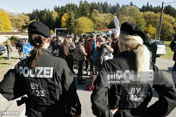 German police gather arriving migrants at the border to Austria on October 28 2015 near Wegscheid Germany Bavarian Governor Horst Seehofer has...
