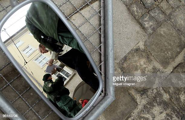 German police officer checks documents of a men entering a police zone prior to the 46th Munich Security Conference next to the Bayerischer Hof hotel...