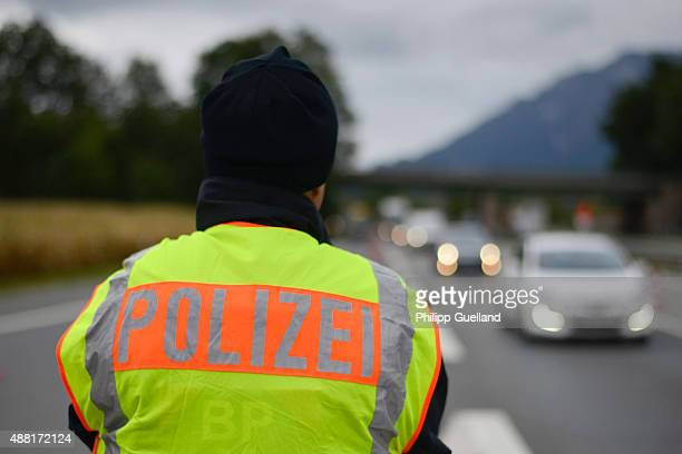 German police officer observes traffic entering Germany at the border to Austria on September 14 2015 near Bad Reichenhall Germany German authorities...