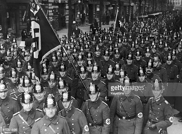 German police officers marching through Berlin to a mass meeting at the Lustgarten where they and other organizations are to be addressed by Johannes...