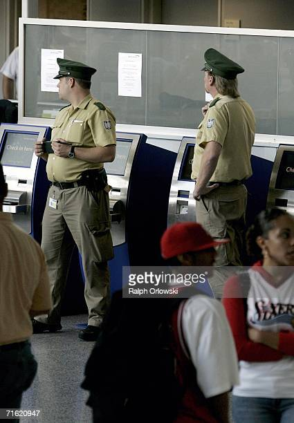German police officers patrol next to a British Airways counter at Frankfurt Airport August 10 2006 in Frankfurt Germany German police heightened...