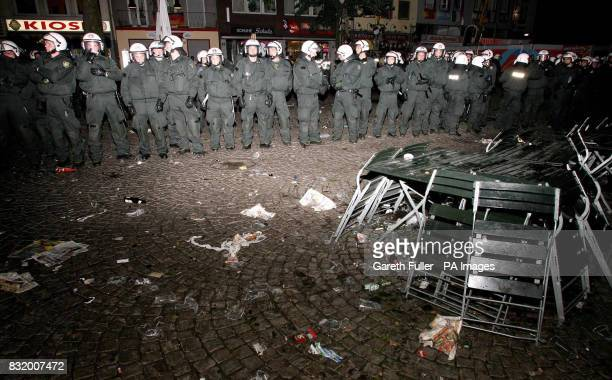 German police officers seal off the Alter Markt as trouble flares in Cologne Germany before England's third World Cup match againt Sweden
