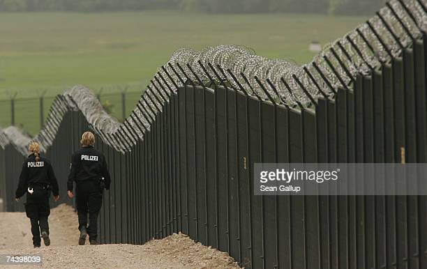 German police patrol along the security fence around the resort of Heiligendamm on June 5 2007 near Heiligendamm Germany German authorities built the...