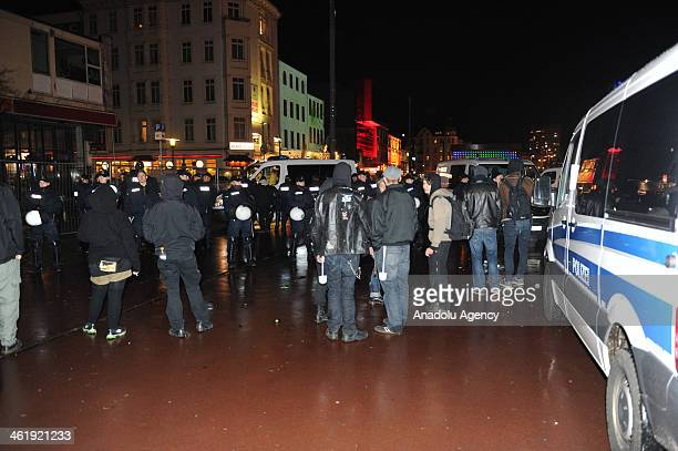 German police perform identity check on people in 'Danger Zones' of Hamburg on January 11 2014 People are seen with toilet brushes became the symbol...