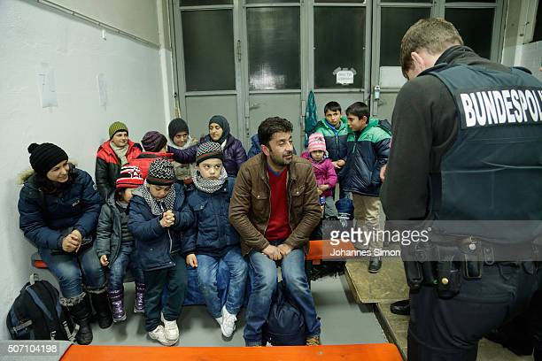 German police search migrants and refugees arriving from Austria at a processing center on January 27 2016 in Passau Germany The flow of migrants...