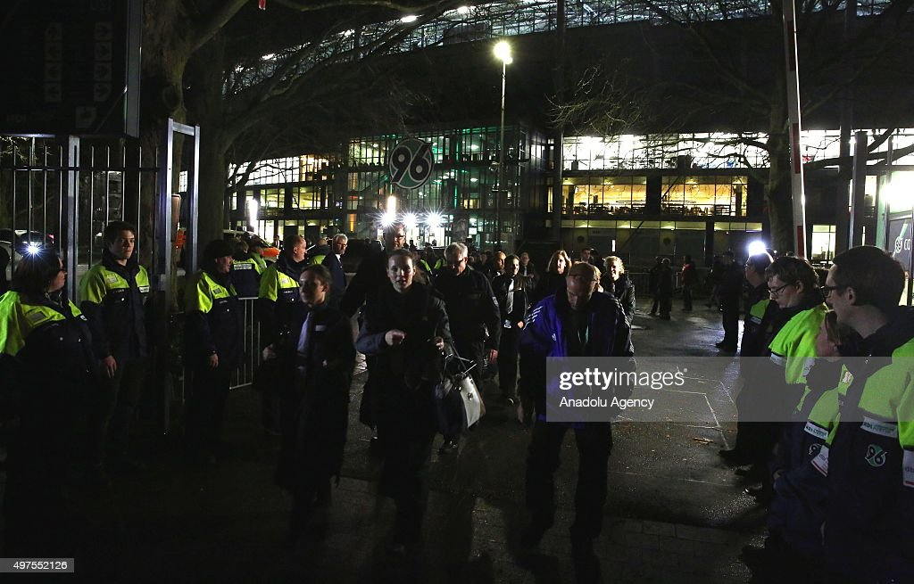 http://media.gettyimages.com/photos/german-police-stand-outside-the-hdiarena-in-hanover-germany-on-17-picture-id497552126