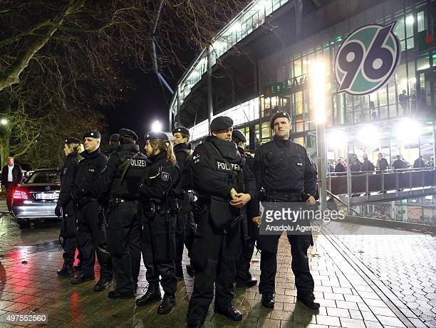 German Police stand outside the HDIArena in Hanover Germany on November 17 2015 The match was called off at short notice due to security concerns and...