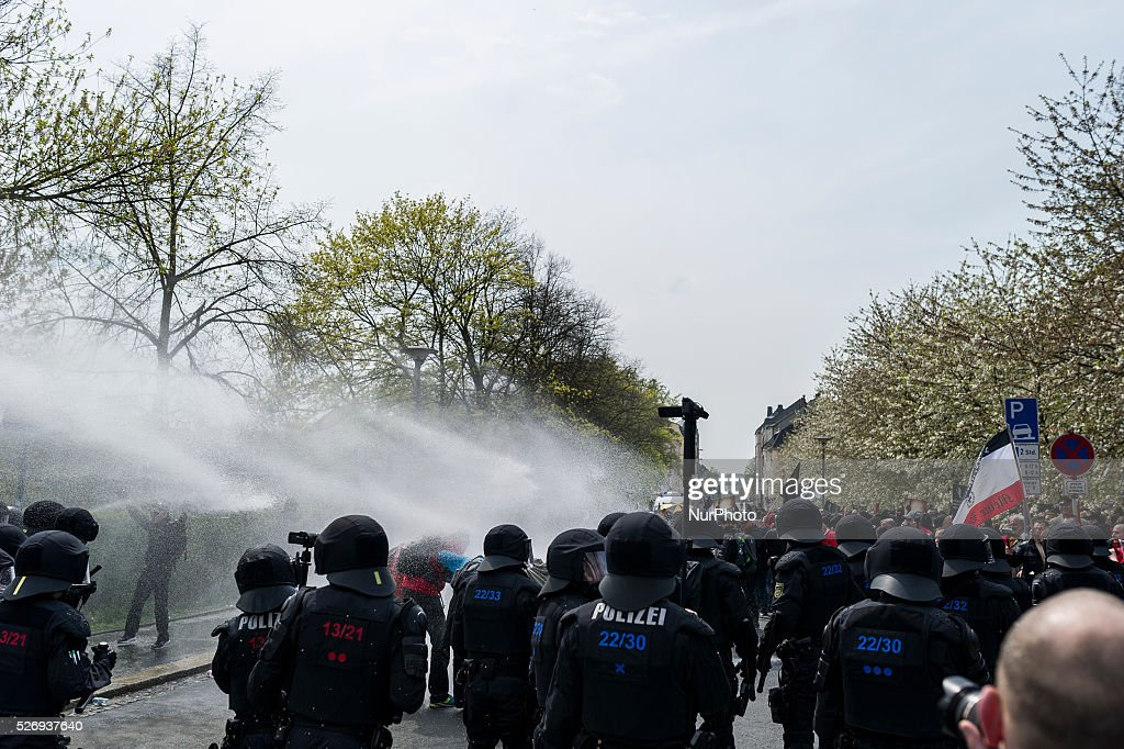 German police use a water gun against participants of a right-wing extremist rally in Plauen, Germany, 01 May 2016.