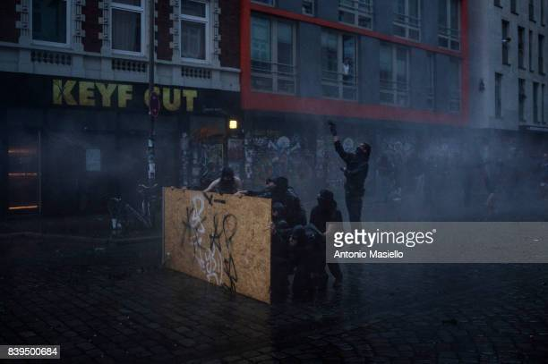 German police using water cannons and tear gas against anticapitalist demonstrators during riots on July 7 2017 in Hamburg Germany German police and...