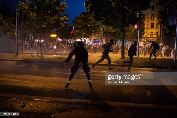 German police using water cannons and tear gas against anticapitalist demonstrators during riots on July 8 2017 in Hamburg Germany German police and...