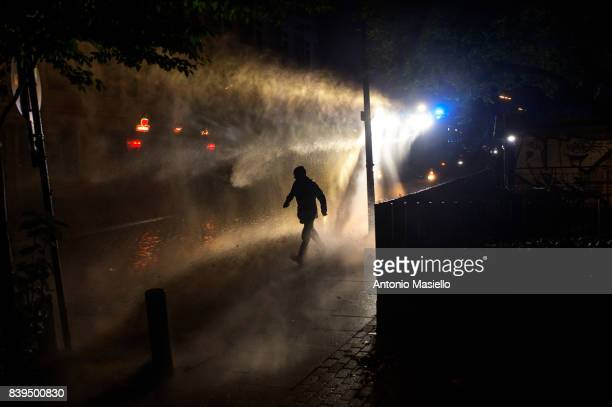 German police using water cannons and tear gas against anticapitalist demonstrators during riots on July 9 2017 in Hamburg Germany German police and...