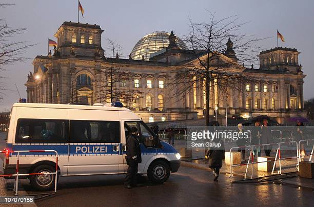 German police van blocks access to the perimeter of the Reichstag seat of the Bundestag or German parliament on November 22 2010 in Berlin Germany...