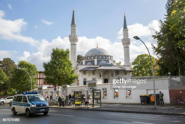 German police vehicle is seen passing by the Sehitlik mosque which is mostly Turkish on Open Mosque Day on October 3 2017 in Berlin Germany Hundreds...